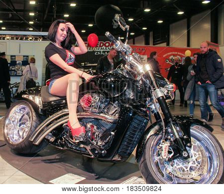 St. Petersburg Russia - 15 April, The fashion model sits on a motorcycle,15 April, 2017. International Motor Show IMIS-2017 in Expoforurum. Models on motorcycles presented at the motor show.