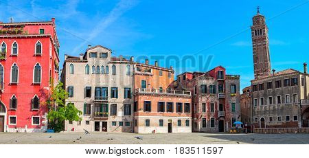 Panoramic view of small town square and old colorful houses in Venice, Italy.