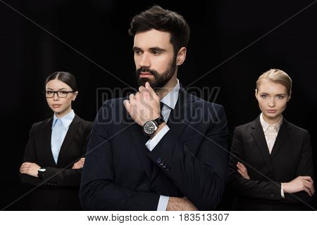 Pensive Business People Standing With Crossed Arms Isolated On Black, Business Establishment Concept