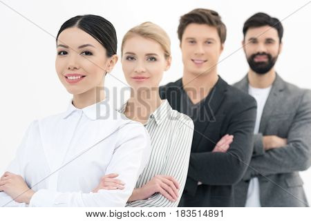 Group Of Young Business People Standing In Row Isolated On White