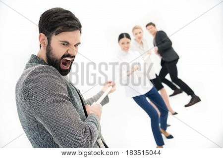 Group Of Business People Pulling Over Rope Isolated On White