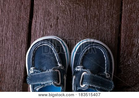 Blue Boat Shoes On Brown Wooden Background. Boy Footwear. Top View.