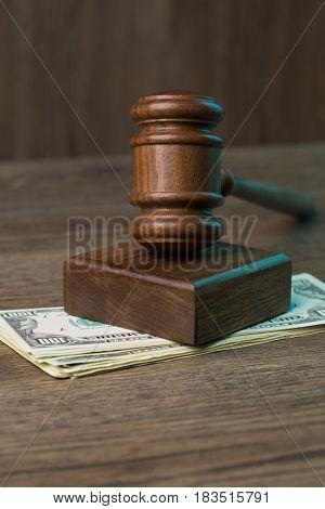 Image of hammer on money