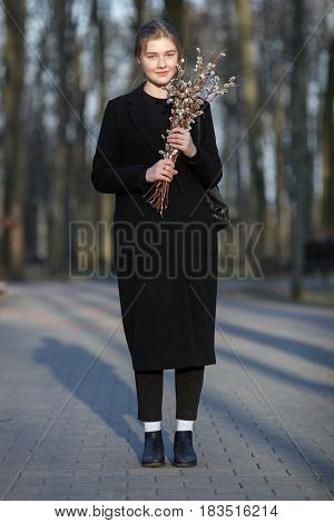 Full Length Emotional Portrait Of Young Happy Beautiful Woman With A Bouquet Of Pussy-willows Wearin