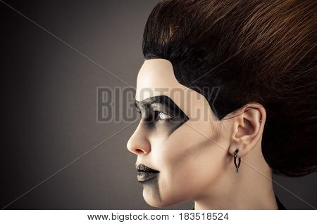 profile face woman with magnificent hair and dark makeup