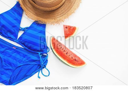 Flat lay of swimwear in blue color with watermelon Summer concept
