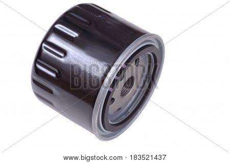 Black oil filter isolated on white background.