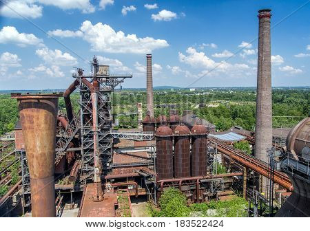 Old industrial buildings and chimneys of abandoned steel mill plant at Duisburg Germany. Now Road of Industrial Heritage.