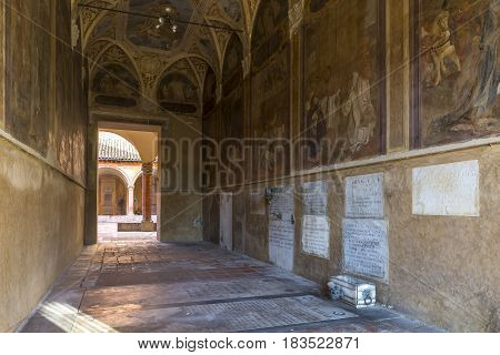 BOLOGNA,ITALY-DECEMBER 12,2016:Old tomb inside the monumental cemetery of the Certosa di Bologna during a sunny day.