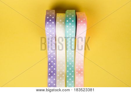 Closeup Of Ribbon Roll Over Colorful Background