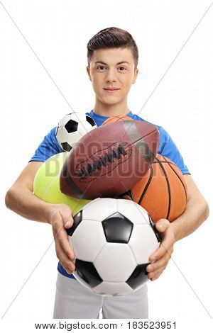 Teenage athlete with different kinds of sports balls isolated on white background