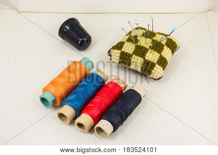 Beautifully Laid Out Accessories For Needlework On A Fabric Background