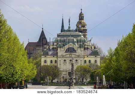 Kosice landmarks - theatre cathedral and column among bright green trees.