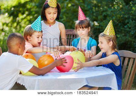 Fun party at interrracial kindergarden as integration activity