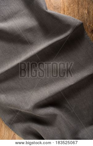 Noble black linen tablecloth on a wooden table
