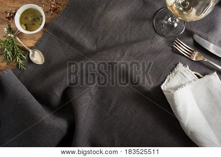 Elegant table decoration with silver cutlery and wine for dinner