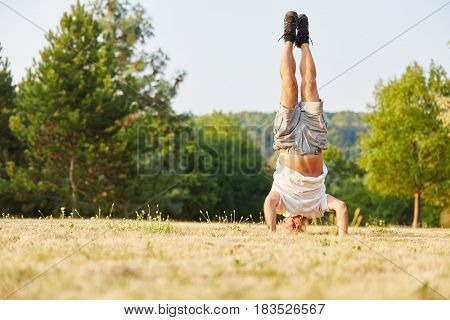 Senior man making a handstand as an excercise for relaxation