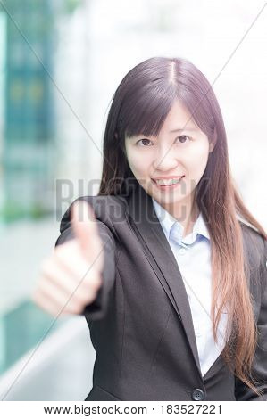 business woman smile amd show thumb up