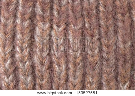 Pink color wool knitted background