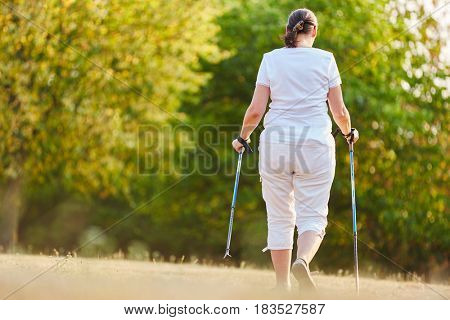 Senior woman hiking in the nature in the summer