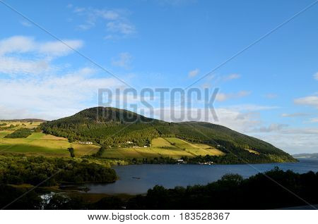 Gorgeous rolling green hills surrounding Loch Ness in Scotland.
