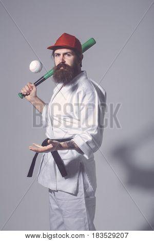 Bearded Karate Man In Kimono, Cap, Green Baseball Bat, Ball