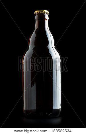 glass bottle of beer on a black background