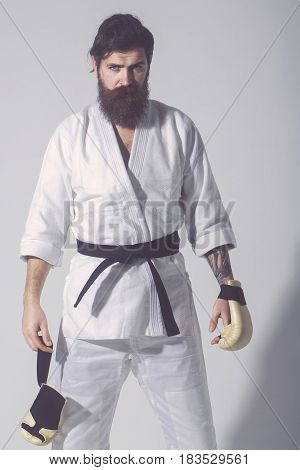 Bearded Serious Karate Man In Kimono And Boxing Gloves