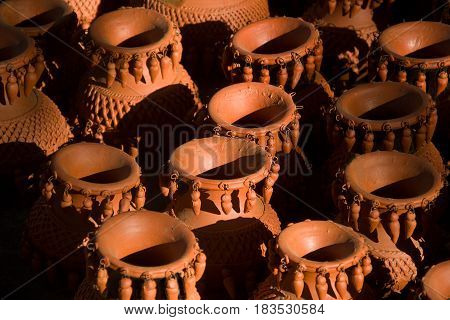 Closer view of heap of artfully crafted red earthen wares