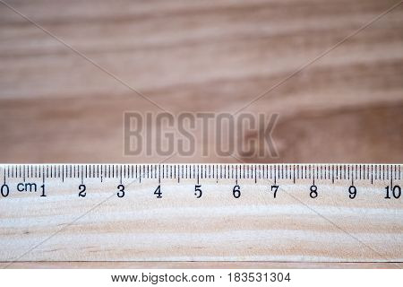 Wooden ruler with brown wood vintage background