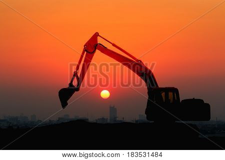 Excavator loader model with Silhouette on sunset at over city building Concept Double exposure