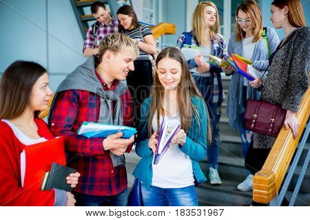 Group of university students meets on a stairway