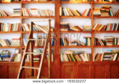 Bookshelf. Library room abstract defocused blurred background