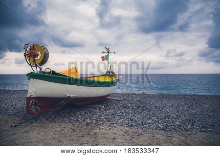 The fishing boat on the shore waiting the storm