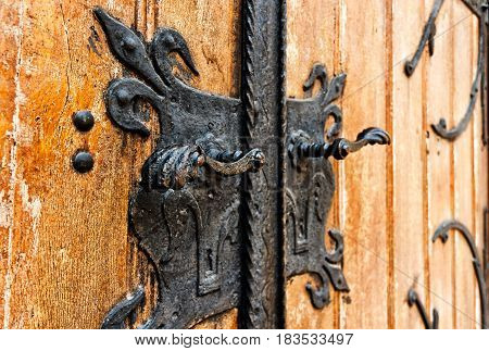Iron handle on a wooden door of an old church