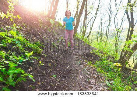 Girl Running In The Woods..
