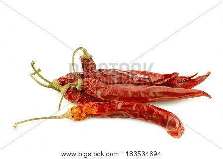 dried red chili peppers (Capsicum) on a white background