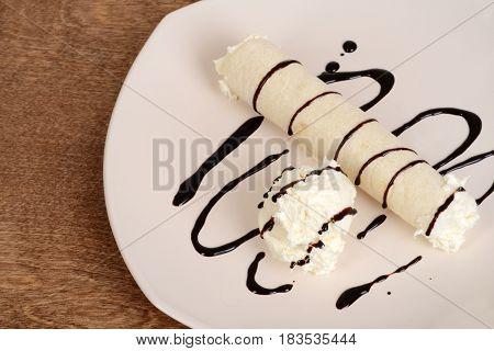 top view vanilla ice cream crepe with chocolate sauce