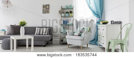 Interior With Sofa, Small Table, White Commode And Armchair