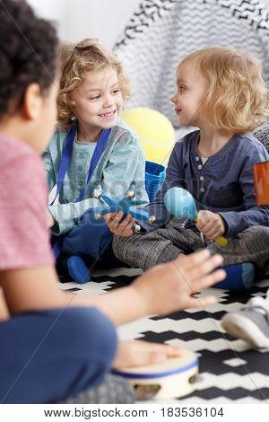 Little boy and girl as friends in kindergarten
