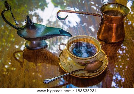 A Cup of coffee prepared in Turkish strong refreshing drink that is so pleasant to drink in the shade South of the gazebo.