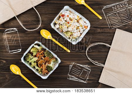 Modern mode of life. Top view of packages lying on tha wooden table near cooked food and daily newspaper