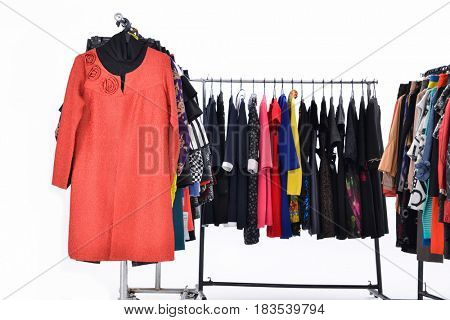 different clothes for females on four hanging