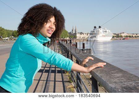 American Black Metis Woman In Front Of River
