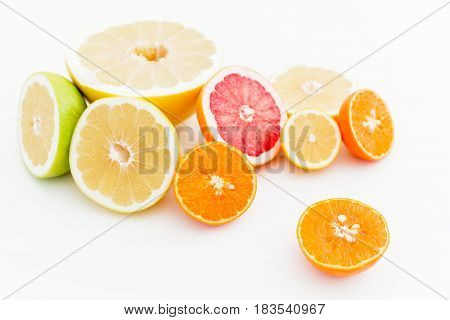 Food pattern of fresh juicy citrus on white background. Flat lay, top view.
