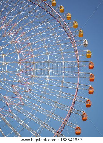 Giant Ferris wheel against the blue sky, Close up image