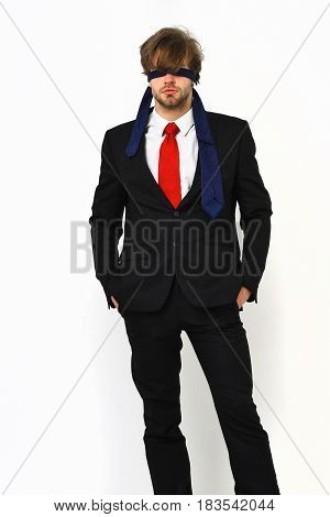 Bearded man short beard. Caucasian stylish serious macho with moustache in elegant suit red tie white shirt with blindfold eyes posing at studio isolated on white background
