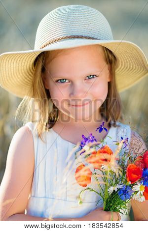 Little Cheerful Girl In A Straw Hat With Wild Flowers Red Poppy Bouquet In The Summer Meadow - Coque
