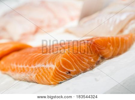 Fillet Fresh Uncooked Seafood Salmon On Showcase Of Seafood Market.