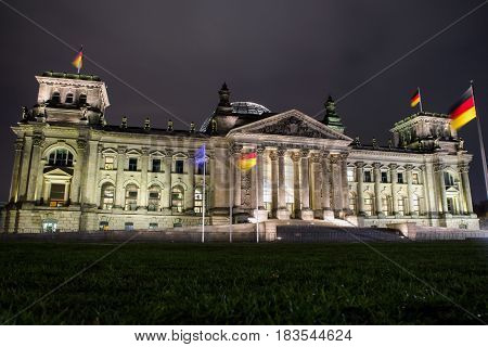 The Reichstag building at night in Berlin Germany. Bundenstag